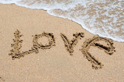 I love you written in the sandy beach